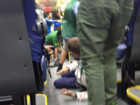 People duck for cover in the aisle as a media bus is attacked travelling between venues in Rio de Janeiro, on the fourth day of the Rio Olympic Games in Brazil. David Davies/PA Wire.