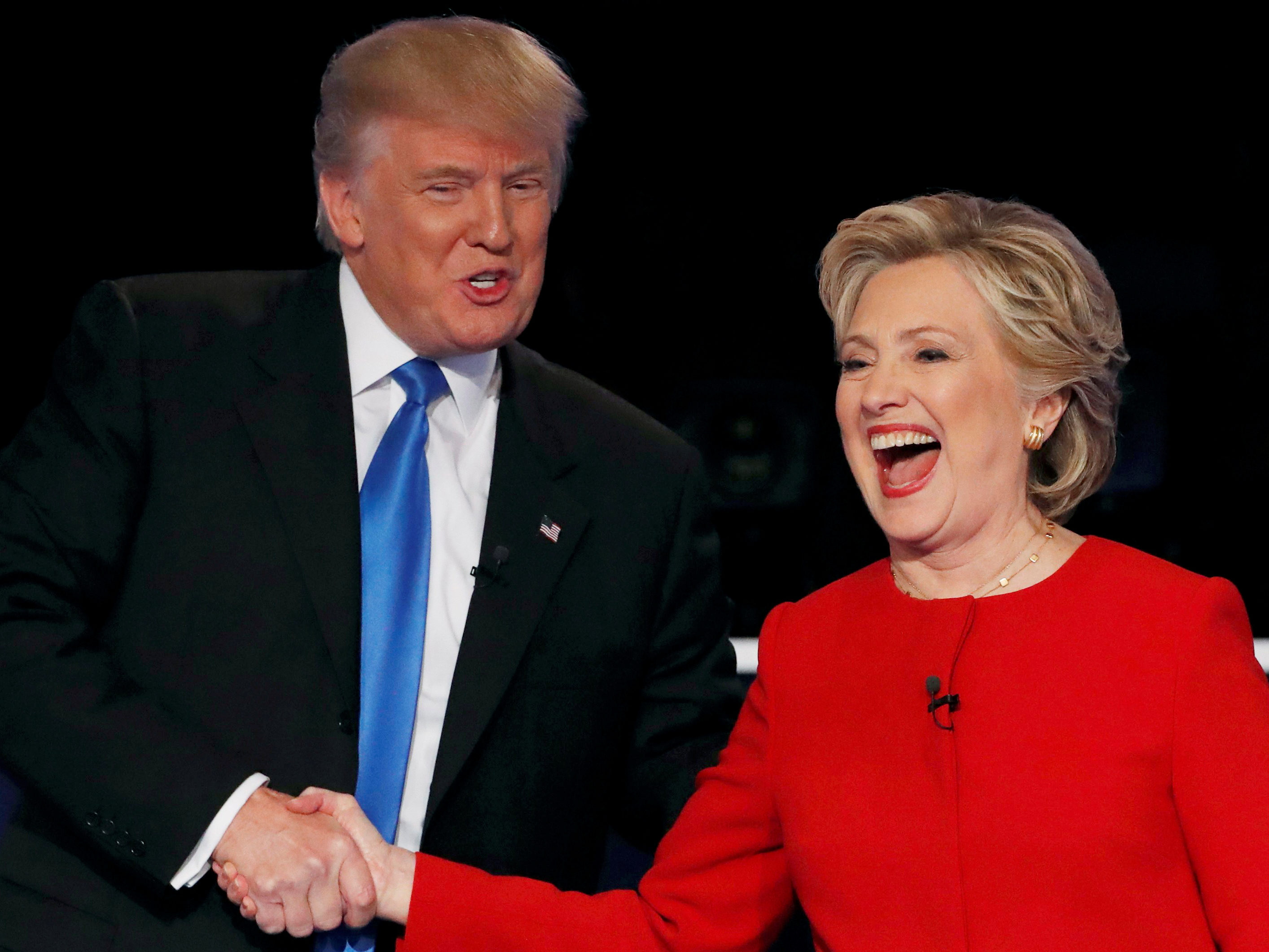 Republican U.S. presidential nominee Donald Trump shakes hands with Democratic U.S. presidential nominee Hillary Clinton at the conclusion of their first presidential debate in New York, September 26, 2016. Picture: Reuters/Mike Segar