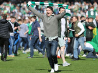 Hibernian fans celebrate on the pitch at the end of the match after winning the Scottish Cup Final against Glasgow Rangers FC. Picture: Reuters / Russell Cheyne