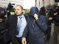 Fake Sheikh Mazher Mahmood (centre) leaves the Old Bailey in London, where he and his driver Alan Smith have been found guilty of conspiring to pervert the course of justice in the case of pop star Tulisa Contostavlos. Picture: Hannah McKay/PA Wire