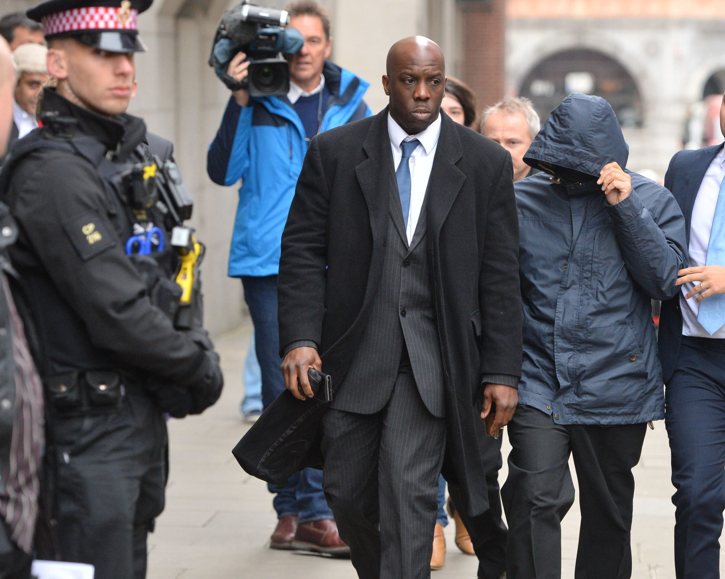 Fake Sheikh Mazher Mahmood (second right) arrives at the Old Bailey, London. Picture: Dominic Lipinski/PA Wire