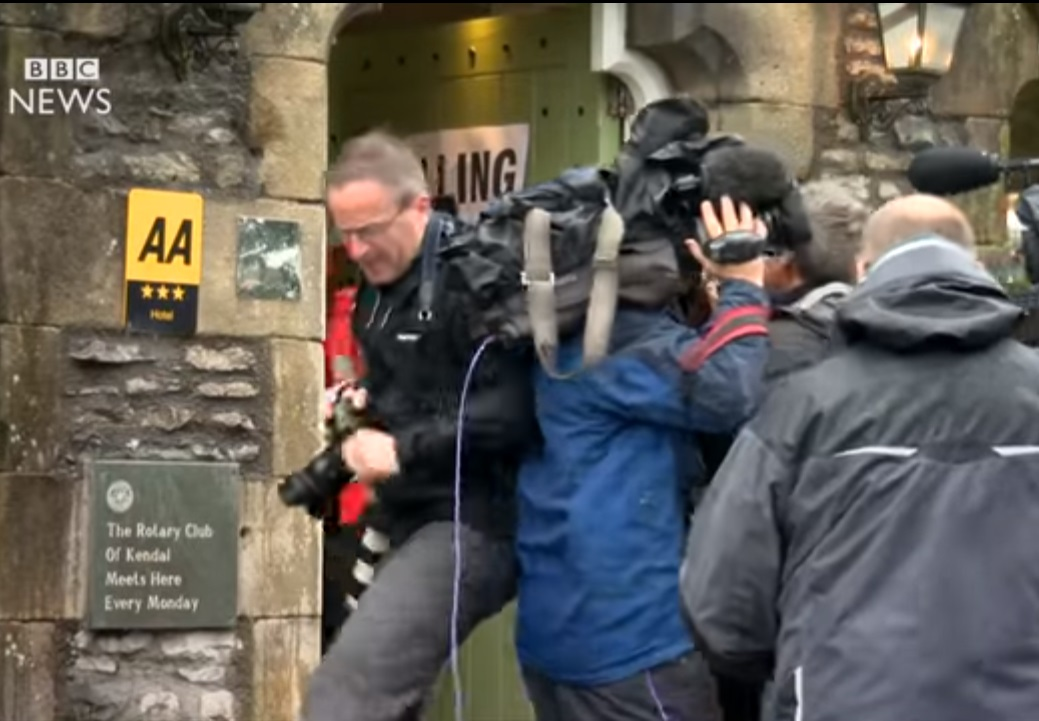 VIDEO: Photographer and cameraman scrap outside polling station in media scrum