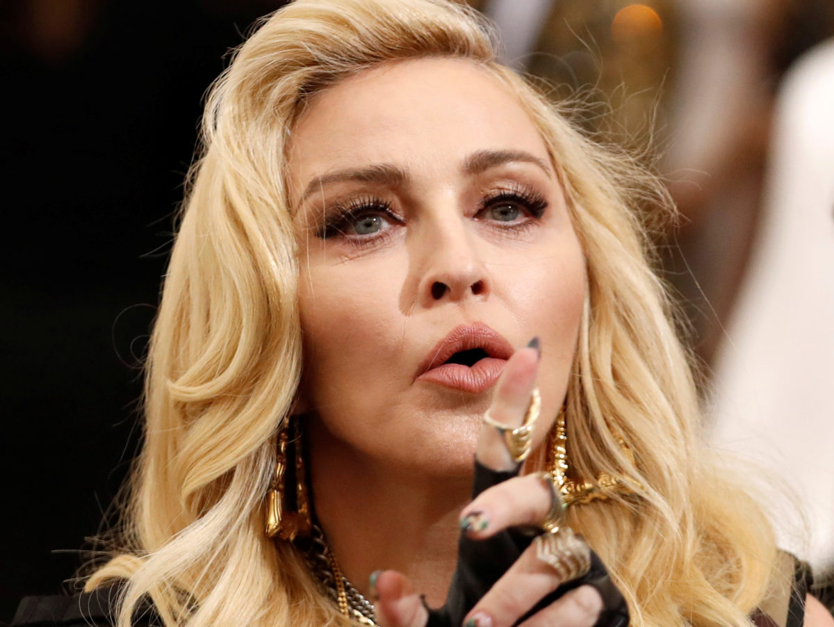 Madonna wins privacy payout over Mail Online story about her adopting twins in Malawi