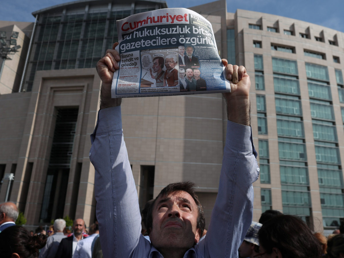 13 Turkish opposition newspaper staff convicted of terrorism offences after trial 'aimed at silencing' their reporting