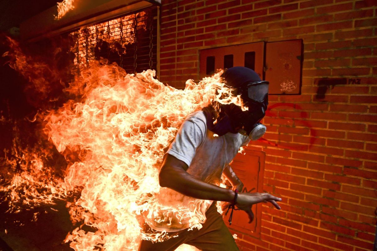 AFP's Ronaldo Schemidt wins World Press Photo of the Year for picture of burning Venezuelan protester