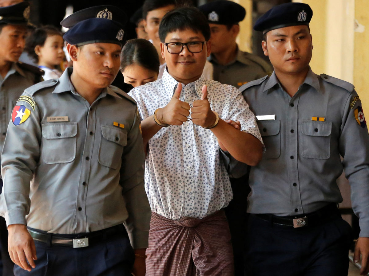 Police witness tells court Myanmar officers gave two Reuters journalists secret documents to 'entrap' them