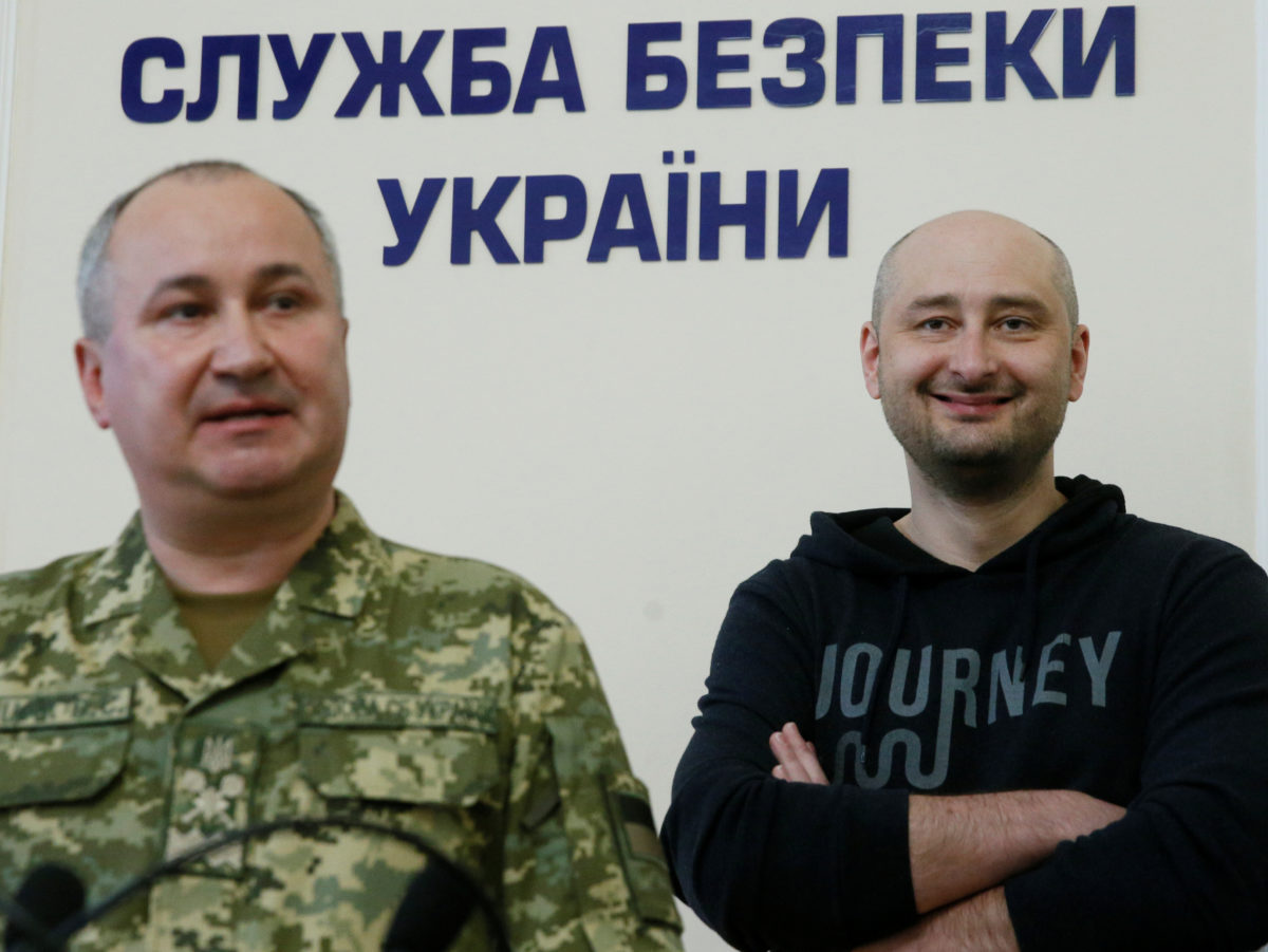 'I'm still alive': Russian journalist back from the dead after police reveal his 'murder' was part of secret plot to capture hitmen