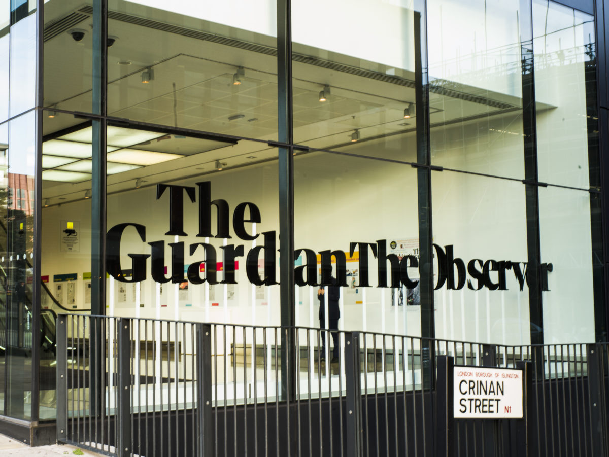 Digital revenues overtake print for first time at Guardian group as it nearly halves losses on track to break even next year