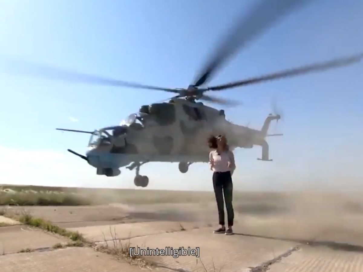 VIDEO: Journalist delivers piece to camera as military helicopter flies inches from her head