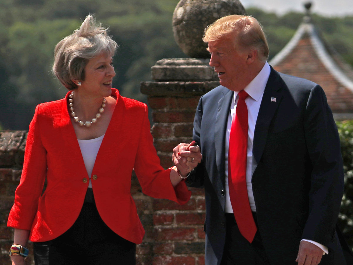 May tells Trump 'don't worry it's only the press' as he cries 'fake news' over claim he criticised her in exclusive Sun interview