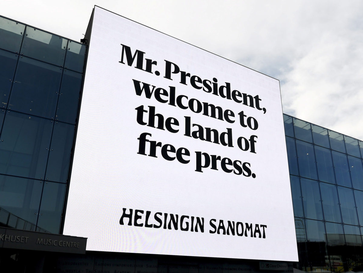 Finnish daily puts up 300 billboard posters along Trump and Putin route to Helsinki summit to remind them of 'importance of free press'