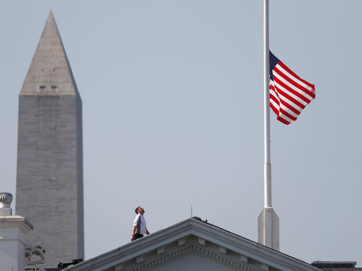 US flags flown at half-mast for five victims of shooting at Capital Gazette newsroom