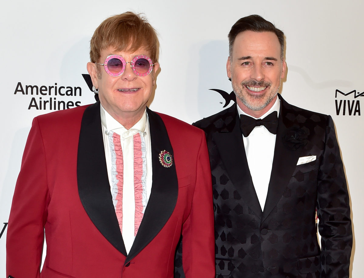 Elton John accepts 'significant' libel damages over Sun on Sunday dog attack story