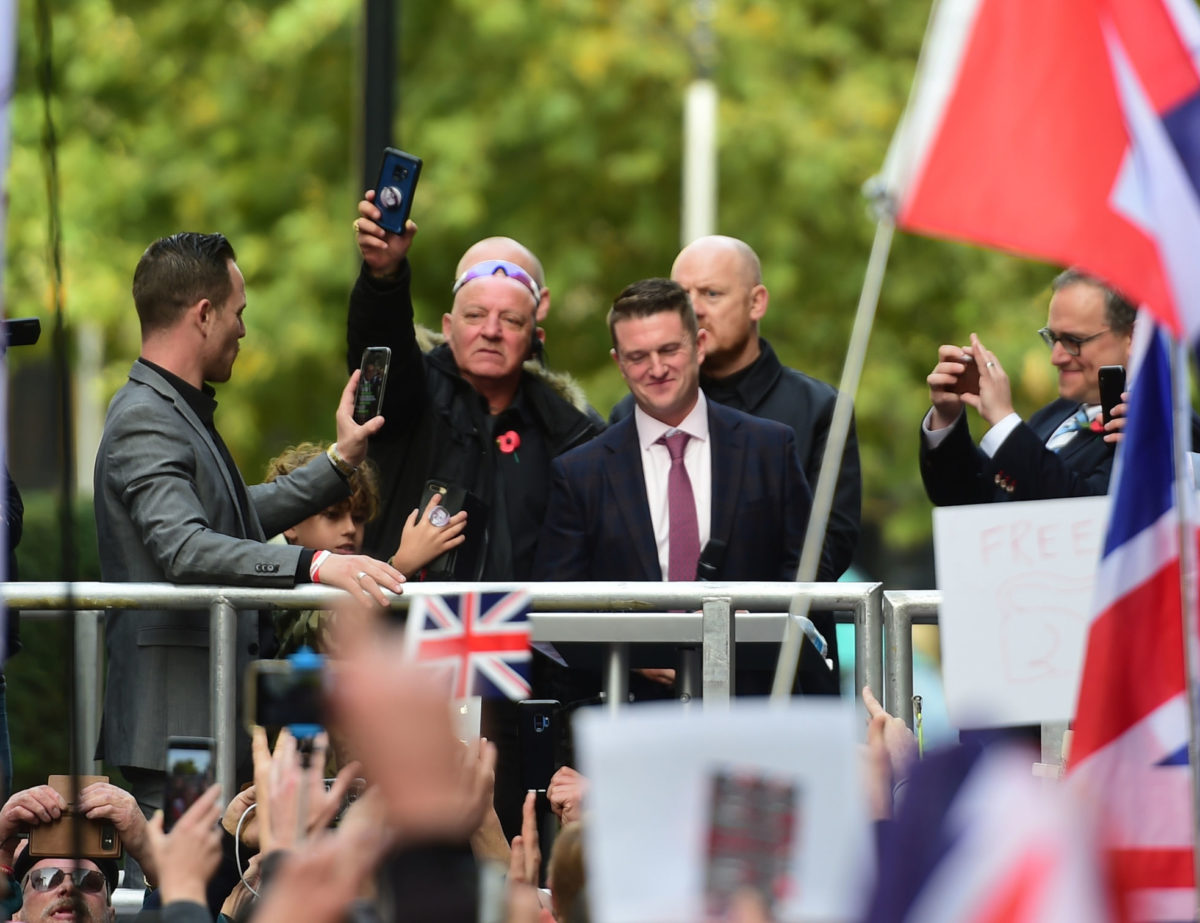 Tommy Robinson supporters chant 'scum' at journalists as EDL founder calls media 'enemy of the people' in attack on free press outside court
