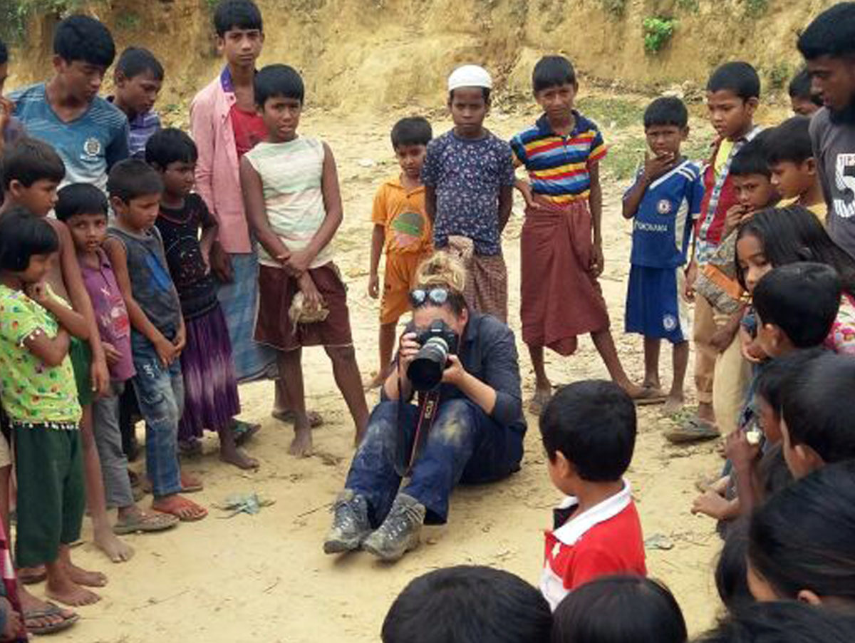 'Sometimes being a human does take over' says Pulitzer Prize-winning Reuters photographer after Myanmar refugee assignment