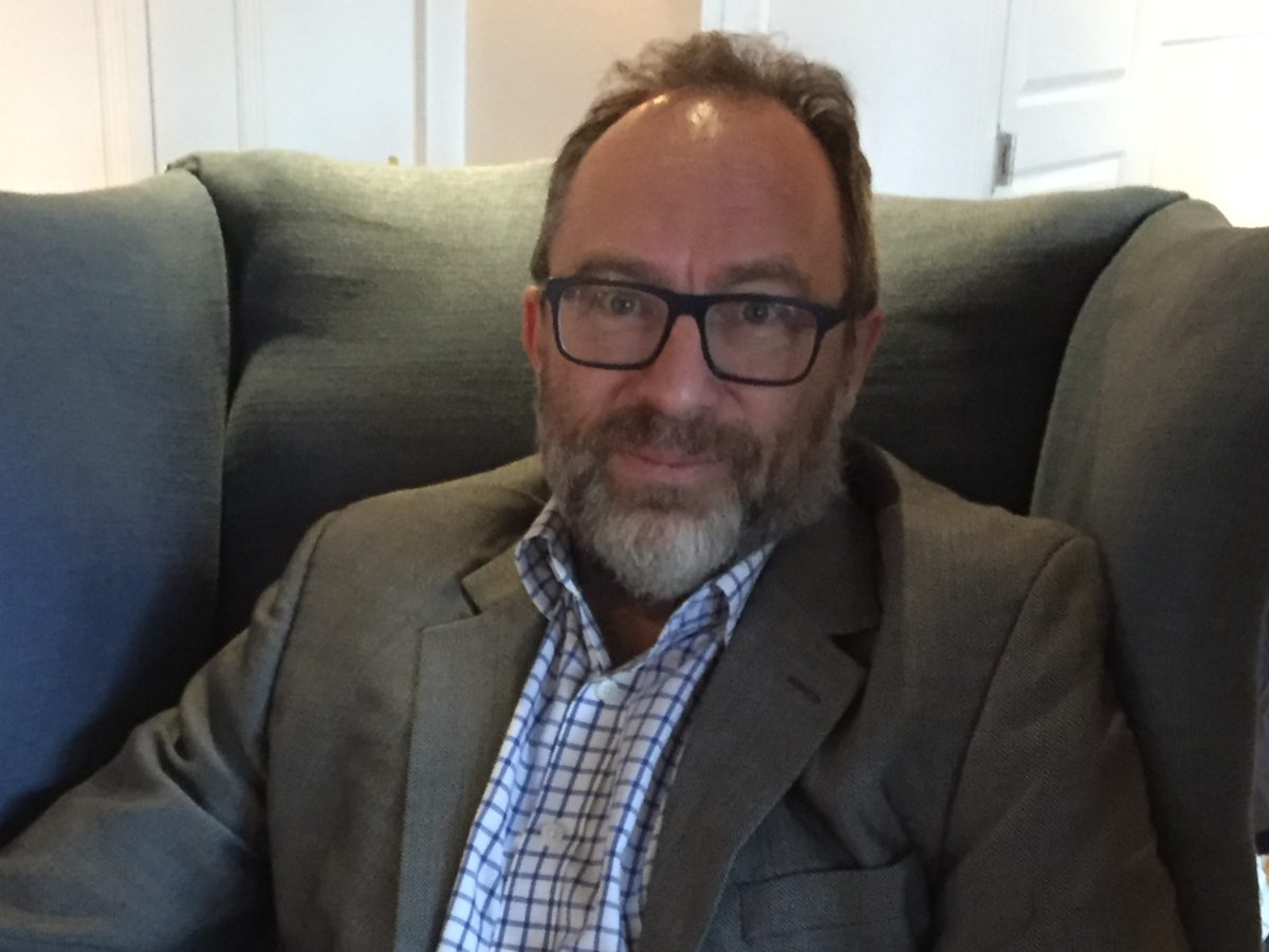 Wikipedia's Jimmy Wales says his crowd-sourced news platform will hire journalists again in future despite cutting staff