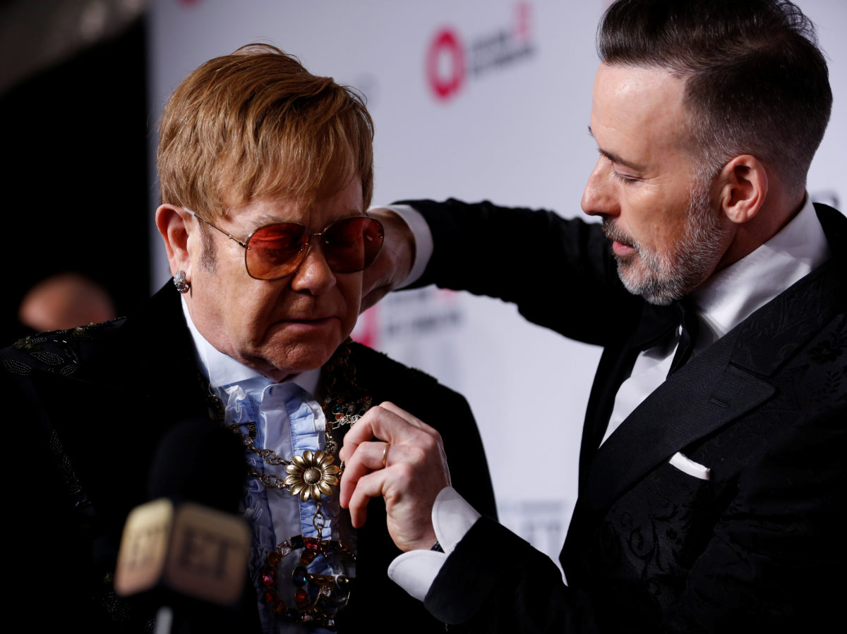 Sir Elton John and husband close to settling phone-hacking claim against Sun publisher, court hears