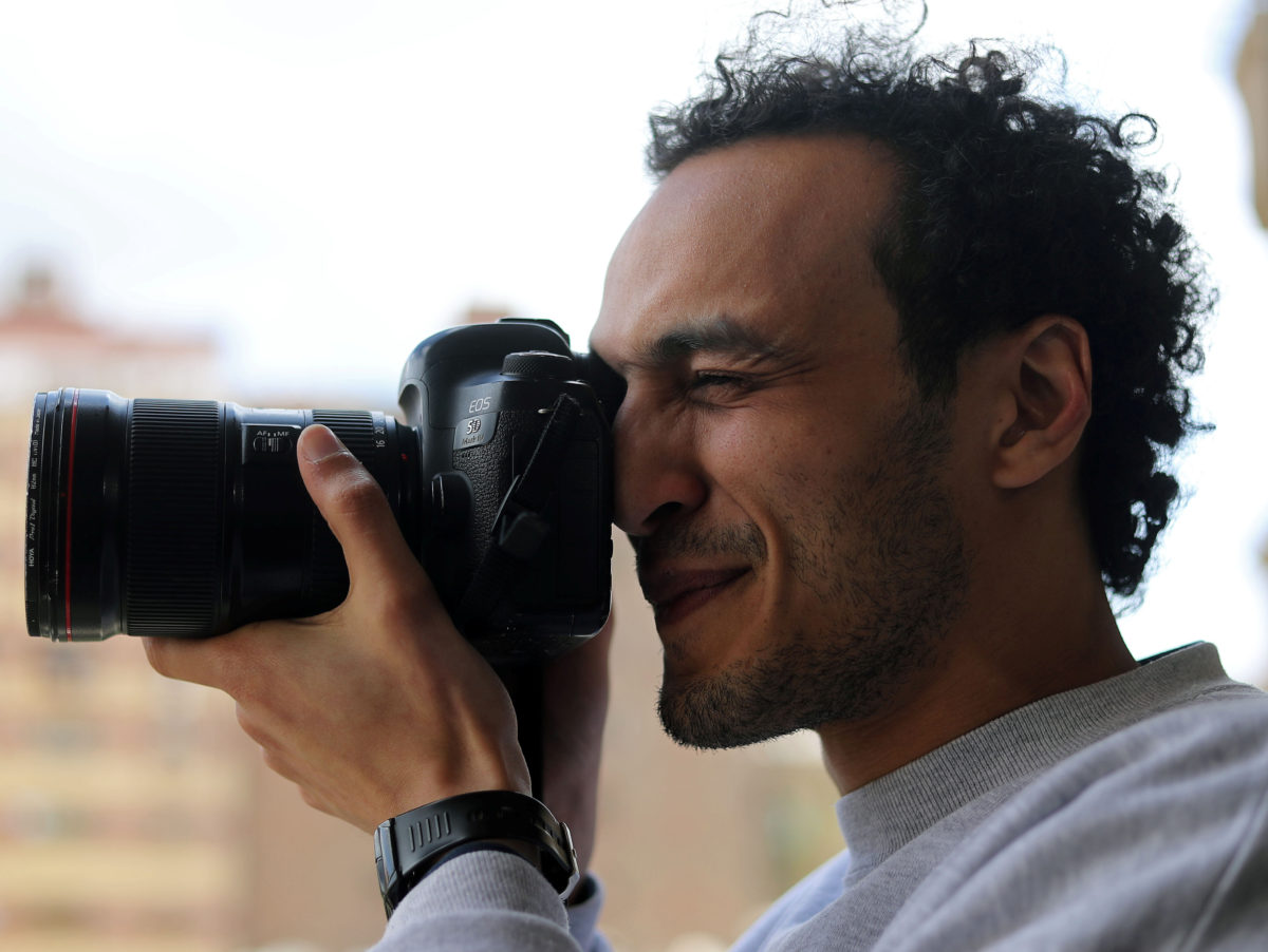 Egyptian photojournalist released from prison after five years but must spend nights at police station