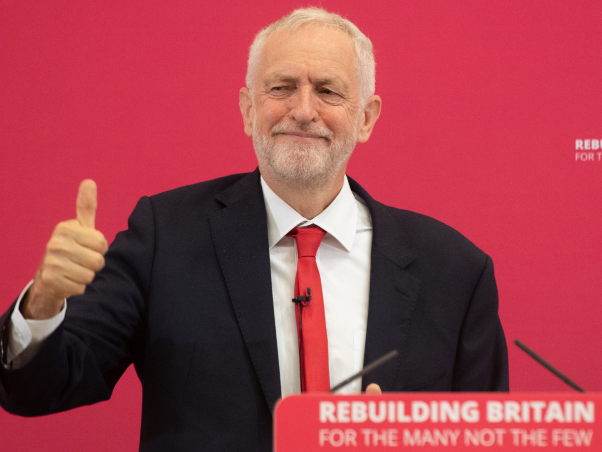 Jeremy Corbyn forced to quiet supporters jeering journalists' questions