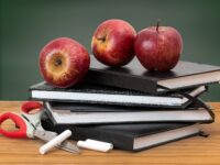 Teacher school classroom apples books