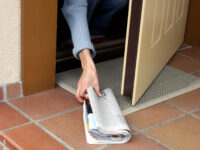 Newspaper home delivery doorstep