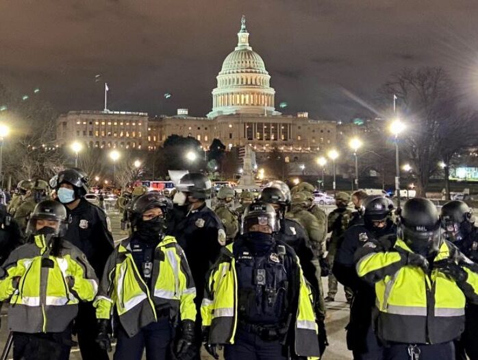 ITV journalist's report from inside US Capitol: 'A crowd of furious men in camouflage wielding heavy wooden sticks encircled us'