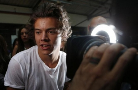 One Direction's Harry Styles wins court orders against four paparazzi photographers