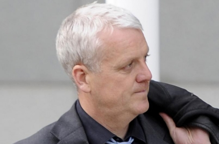 News of the World features editor Jules Stenson pleads guilty to phone-hacking as Neil Wallis denies offence