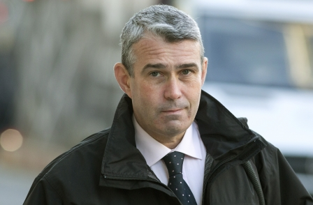 Hacking trial: News International security chief 'dug a hole in his garden and burnt stuff'