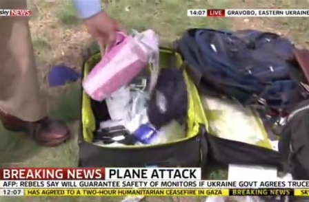 Sky News apologises after reporter looked through MH17 luggage during live broadcast