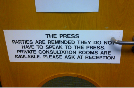 Public notice at tribunal office warns against speaking to journalists