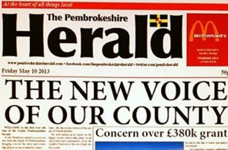 Publisher stands by decision to attack rival newspaper as editor resigns in protest