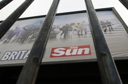 Police officer charged with selling information to The Sun