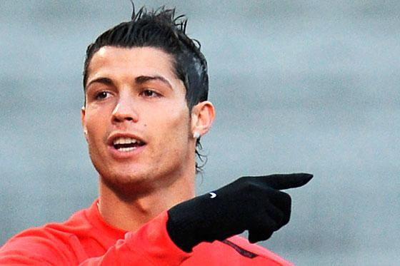 Sun pays damages to Cristiano Ronaldo over phone story