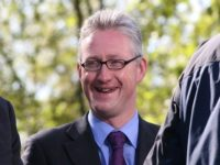 Former MP Lembit Opik wins privacy complaint against Sun over pics of him 'nuzzling' woman while on holiday