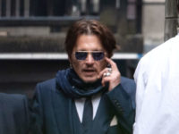 Johnny Depp appears at High Court in libel case against Sun over 'domestic abuse' article